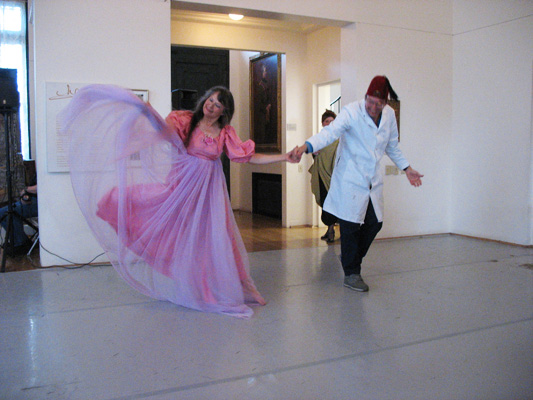 Performing a Loie Fuller dance at the Maryhill Museum, with Carol at left (2008).
