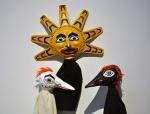 White Raven, Sun, and Black Raven. Papier mâché and fabric.