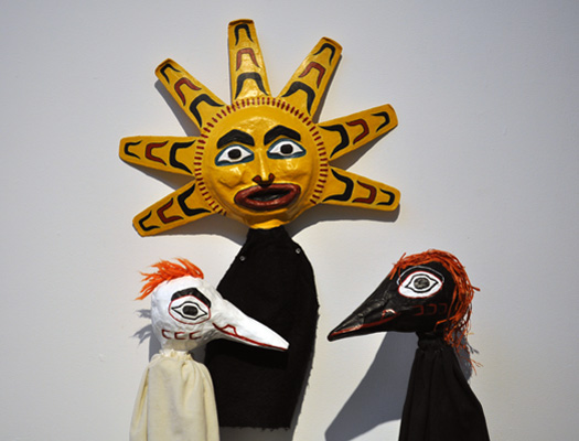 White Raven, Sun, and Black Raven. Papier mâché and fabric.