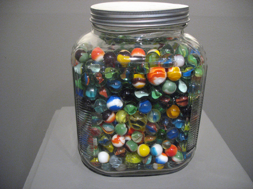Circles (2007). Glass marbles, glass jar.