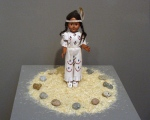 Cowboys and Indians (2007). Doll, straw, pebbles.