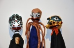 Kumugwe, Octopus, and Yagim. Papier mâché, fabric, and metal.