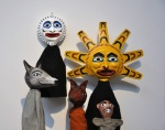 Coyote, Moon, Fox, Sun, and Otter. Papier mâché and fabric.