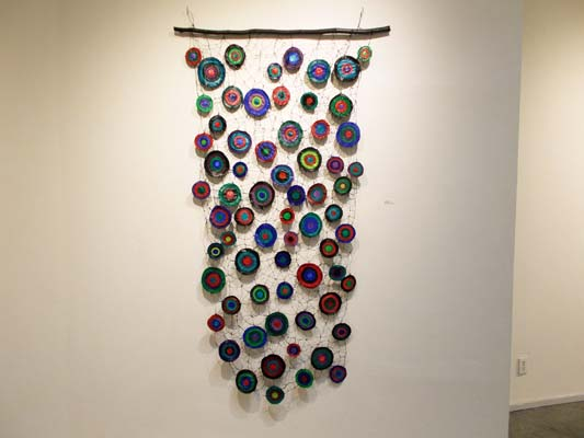 """Sewing Circles 2 (2014). 80"""" x 42"""". Oil on canvas and wire."""