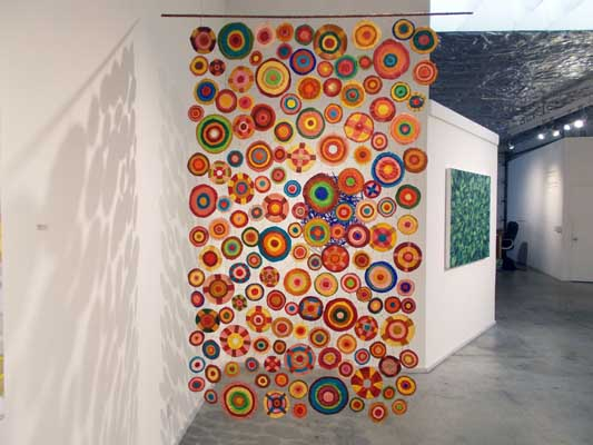 "Sewing Circles (2013): installation view (Side 1). 84"" x 48"". Oil on canvas and wire."