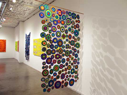 "Sewing Circles (2013): installation view (Side 2). 84"" x 48"". Oil on canvas and wire."